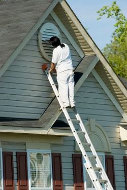 Exterior Painting being performed by an experienced Painter's Logic painter.